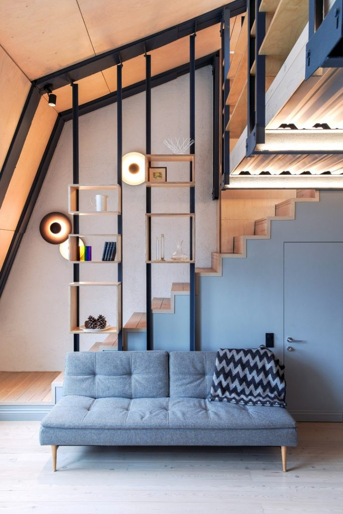Под крышей: интерьер мансардной студии площадью 40 м²