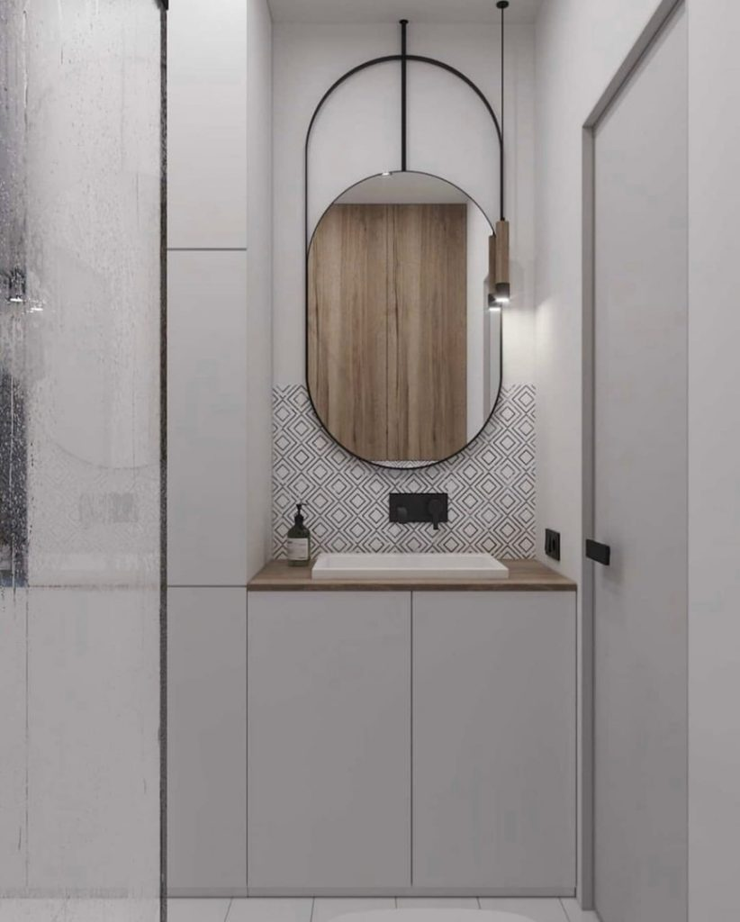 Минималистичный интерьер однокомнатной квартиры площадью 32,5 м² с почти традиционной планировкой